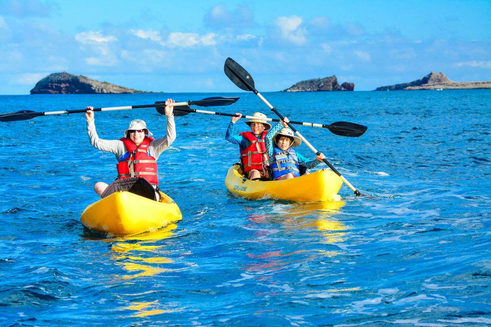 Family kayaking in Galapagos.
