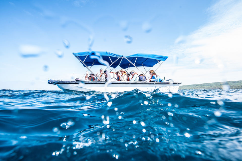 Glass-bottom boat sailing in Galapagos.