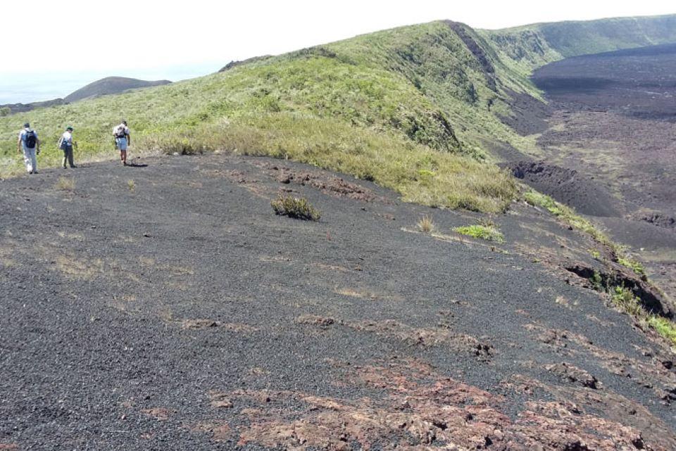 Guests walking around volcan Sierra Negra in Isabela Island.