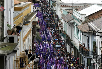 Quito's cucuruchos during the parade of Holy week in downtown.