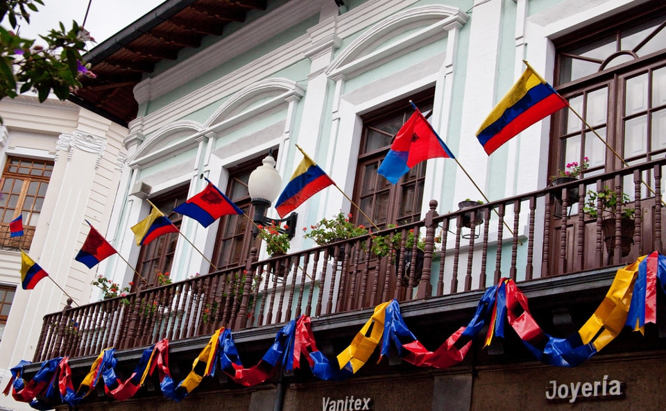 Ecuadorian and Quito flags on display in downtown Quito.