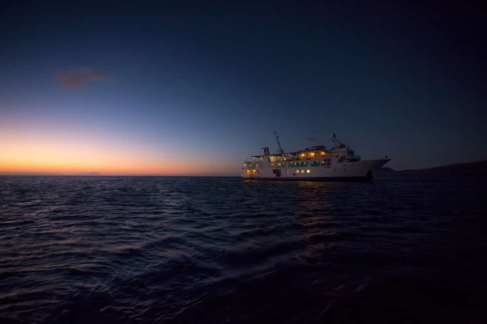 Yacht Isabela II at sunset in the Galapagos Islands.