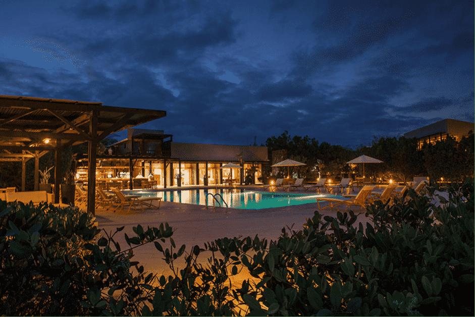 Finch Bay Hotel pool at night.
