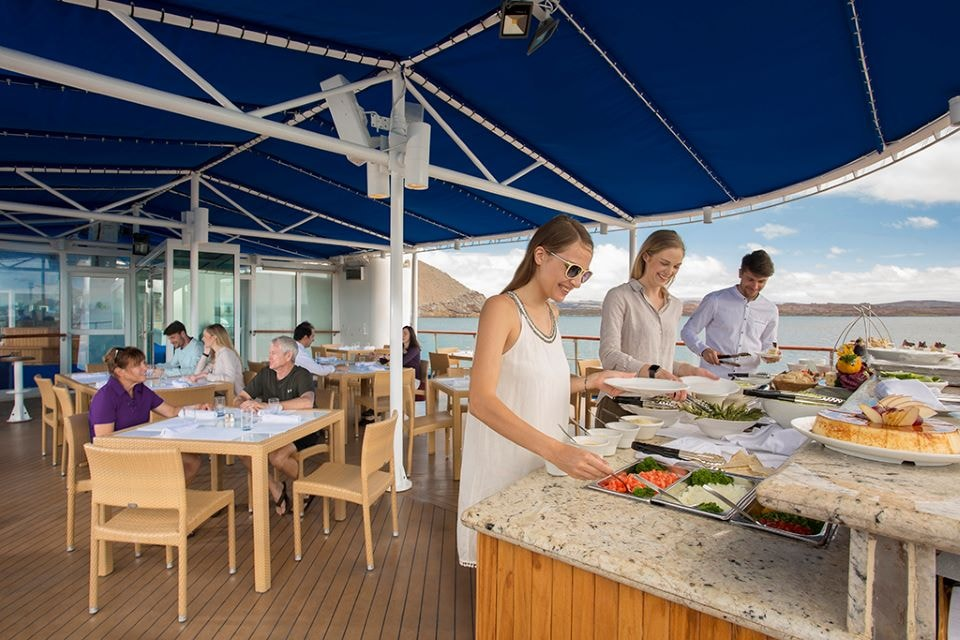Guests in the restaurant aboard Yacht Isabela II: