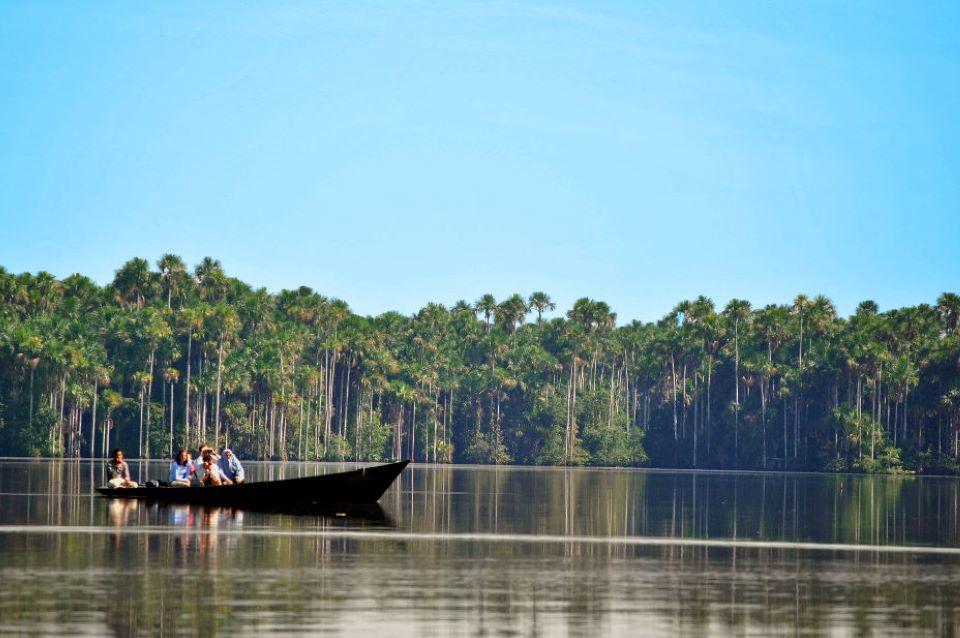 Canoe trip in the Amazon Rainforest river.