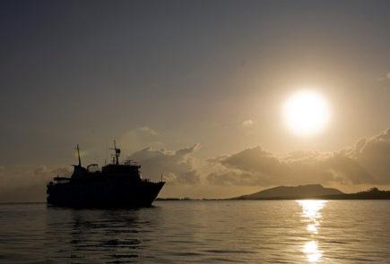 Yacht La Pinta in the Galapagos Islands at sunset.