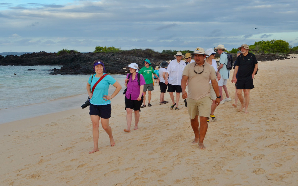 Guests walking in the shore.