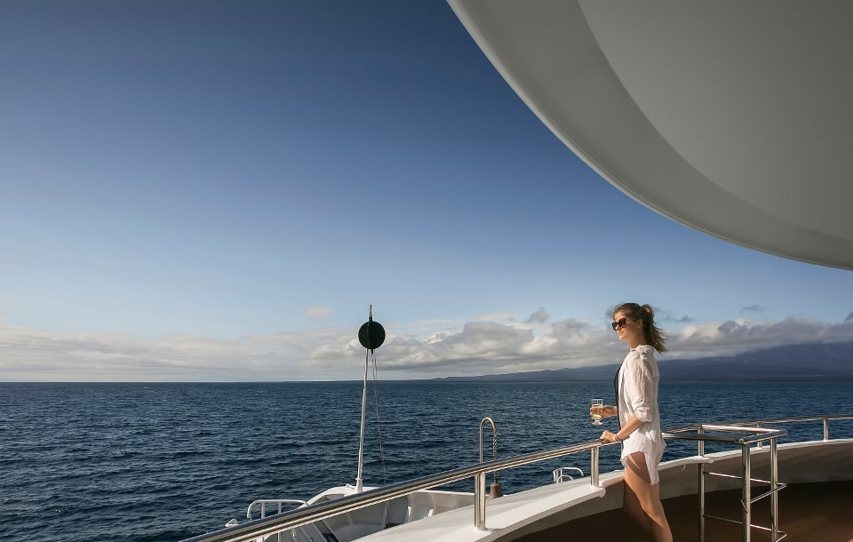 Guest enjoying the view aboard Galapagos cruise.
