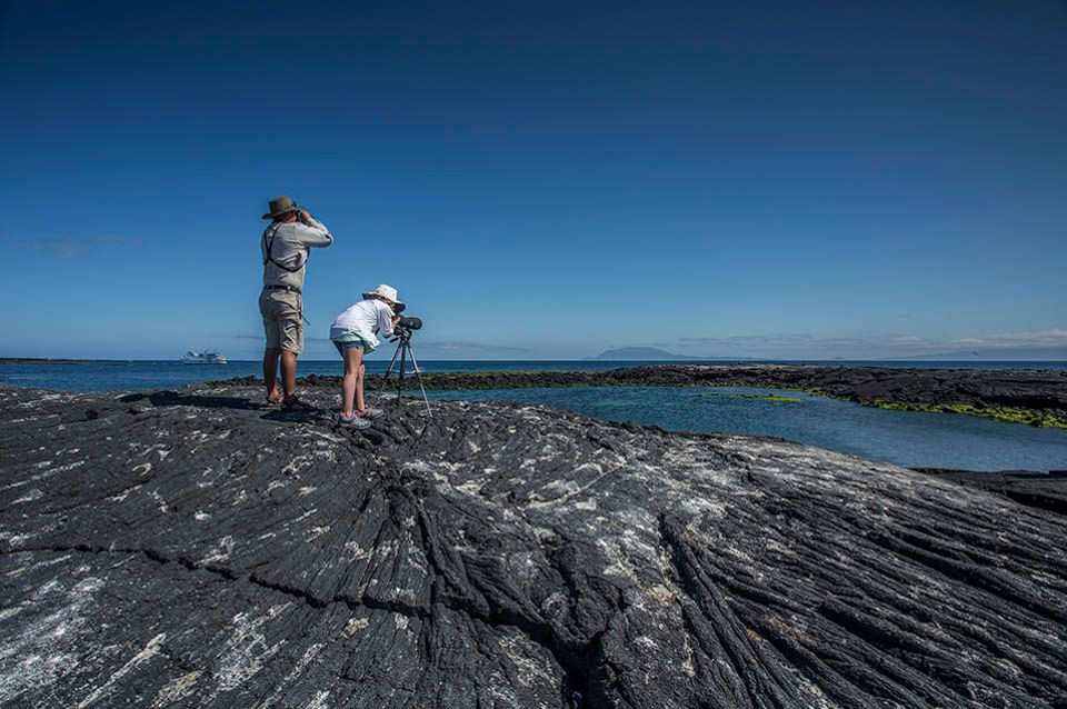 Guests observing the Galapagos Islands Landscape.