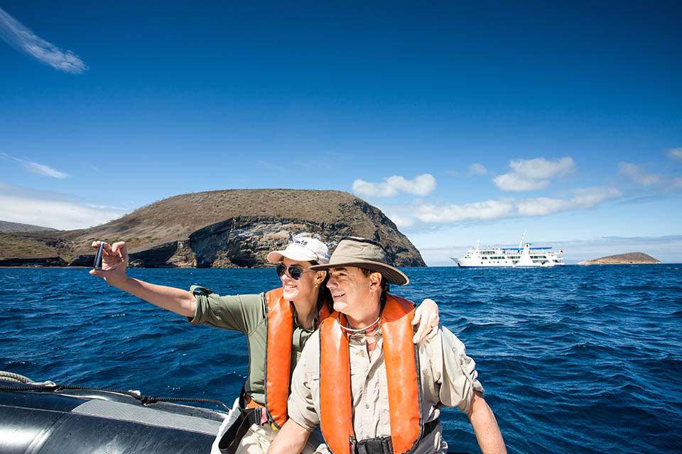 Guests experience panga ride in Galapagos.