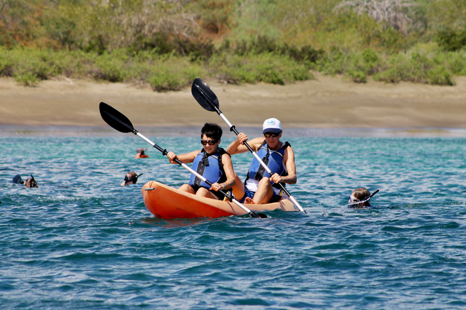Couple kayaking in Galapagos.