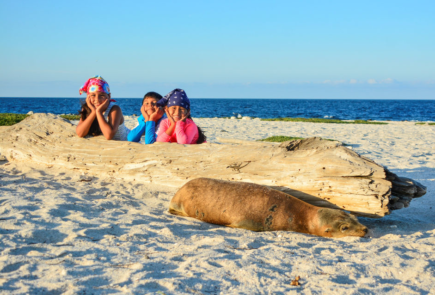 Kids enjoying beach in Galapagos Islands