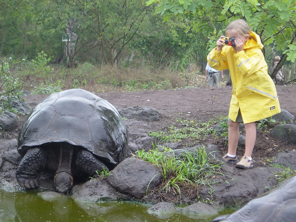 Children encounter with a Galapagos giant tortoise.