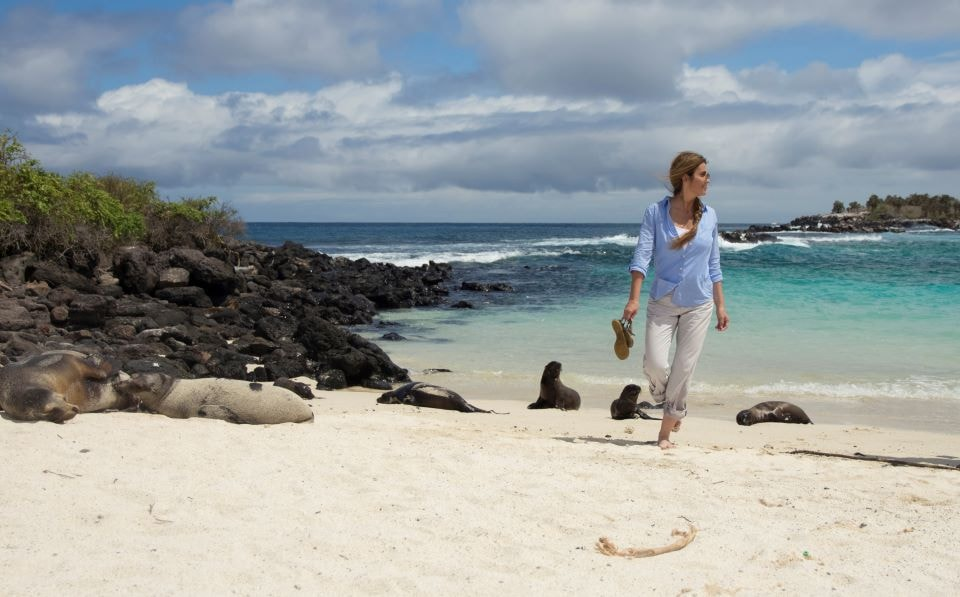Guest walking in the beach of the Finch Bay Hotel.