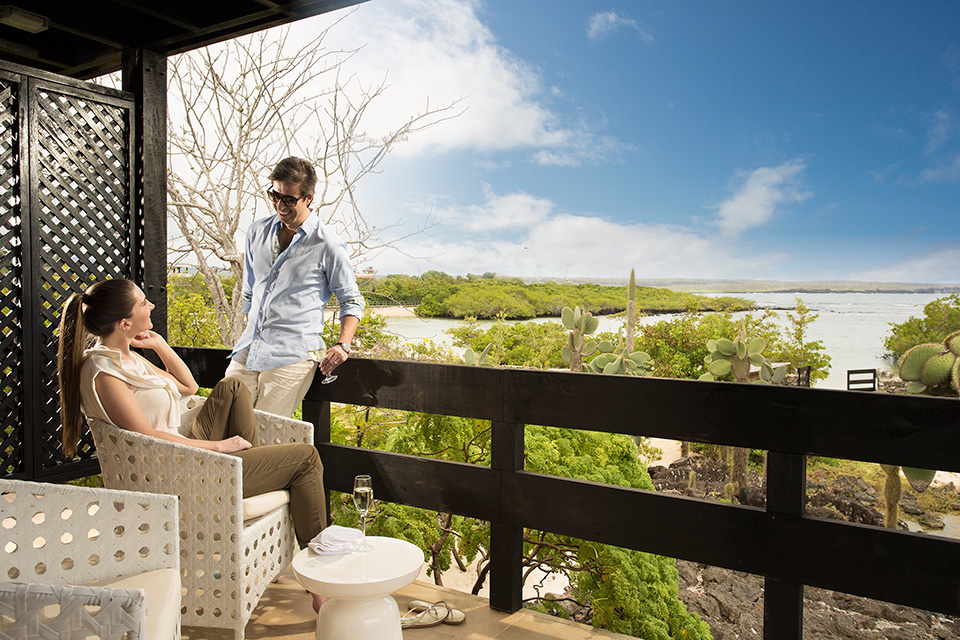 Guests in The Finch Bay Hotel suite balcony.