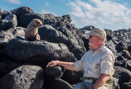 Senior guest with Galapagos wildlife