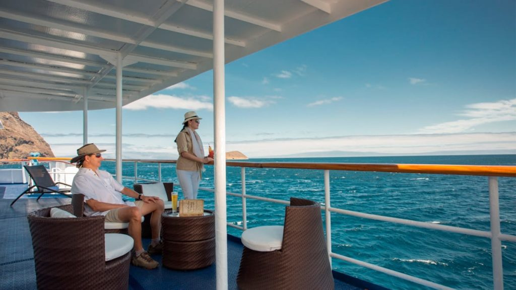 Guests in the sun deck in Yacht Isabela II.