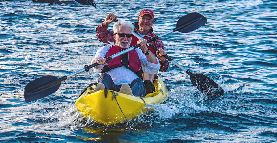 Senior guests kayaking in Galapagos