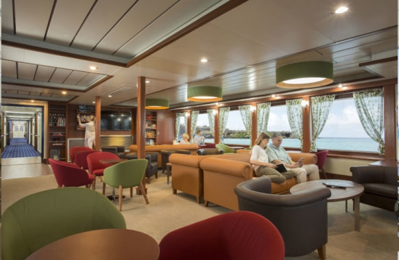Expedition lounge and library aboard Santa Cruz II.