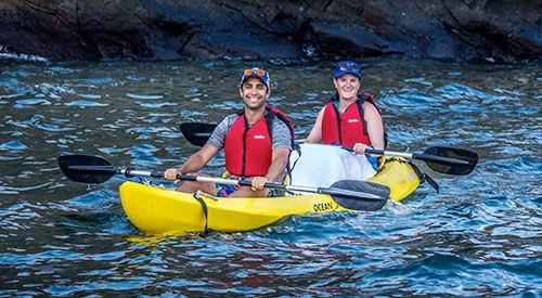 Couple enjoy sights while kayaking in Galapagos, Ecuador