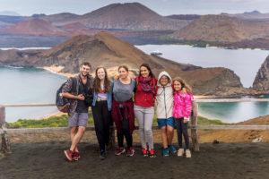 Family poses at the top of Bartolome in the Galapagos Islands, Ecuador