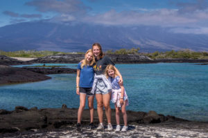 Girls posing on Fernandinda Island, Galapagos