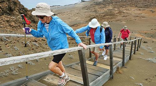 Visitors on hiking trail in Galapagos, Ecuador