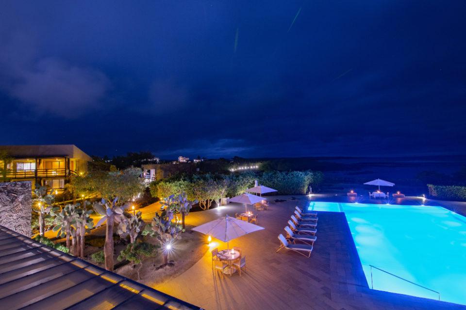 Finch Bay Galapagos Hotel's pool at night